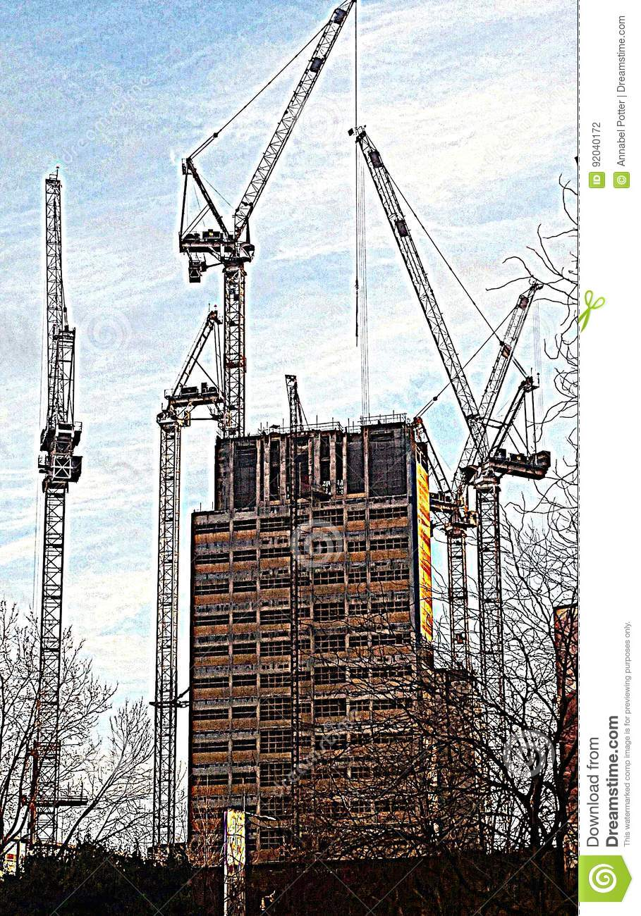Cranes surrounding a building