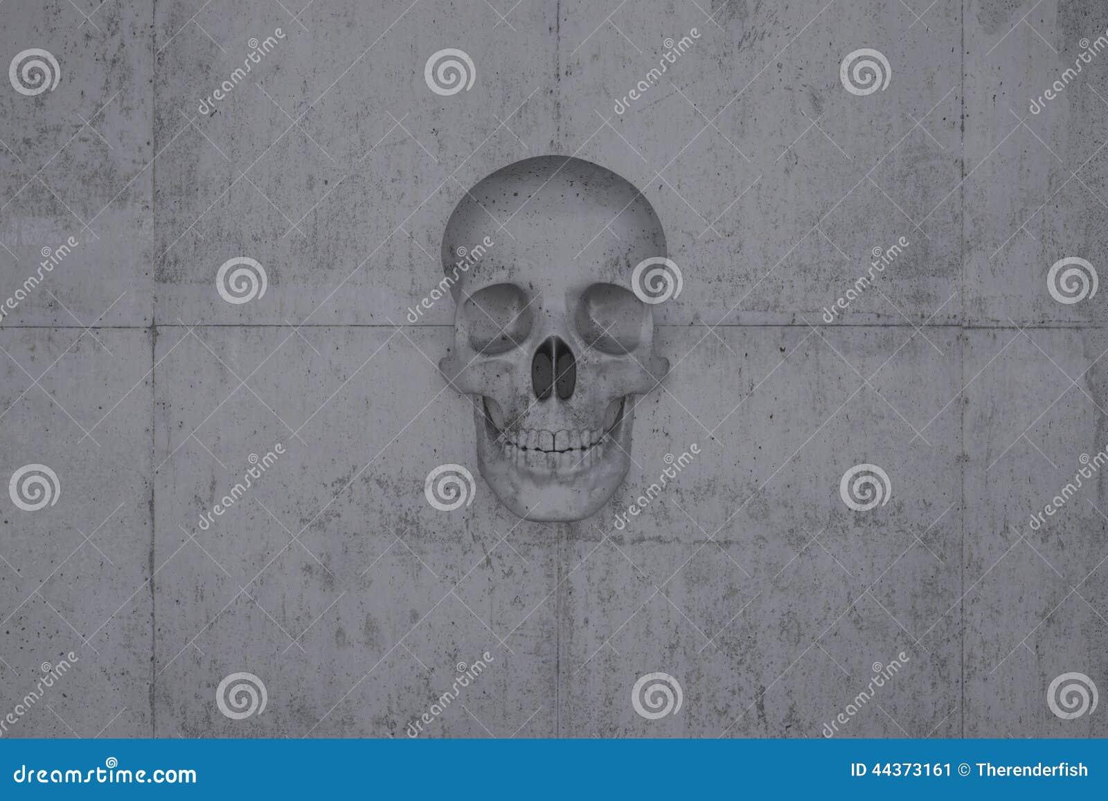 Cranio su una parete di calcestruzzo