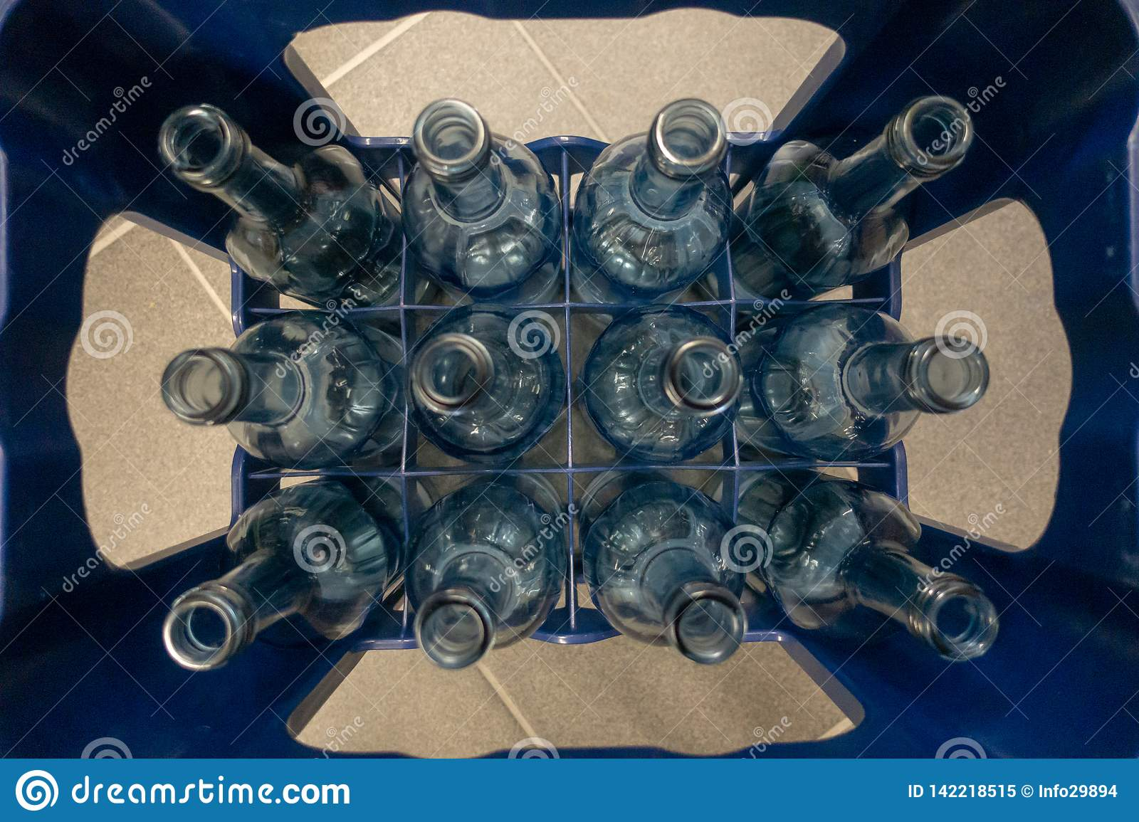 A crate with empty glass bottles