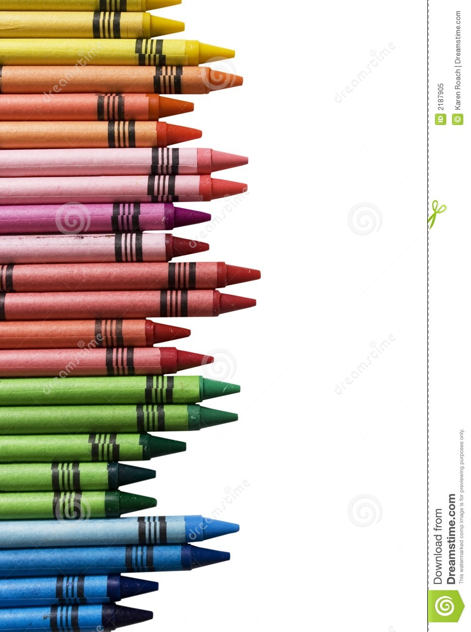 Crayons in arrange in color wheel colors on white background.