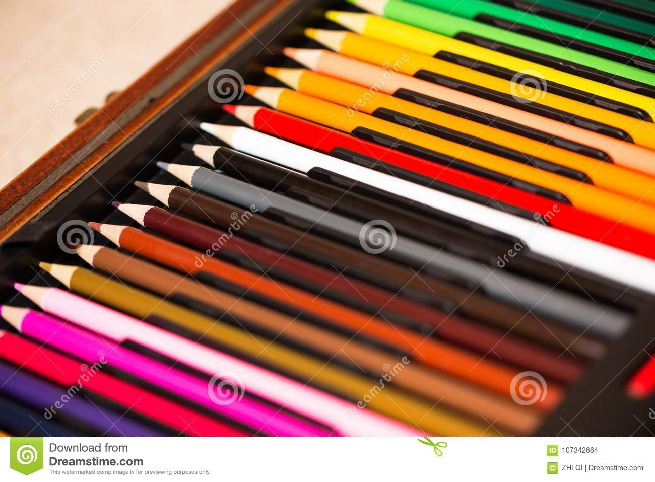 crayons colored pencil set loosely arranged on white background