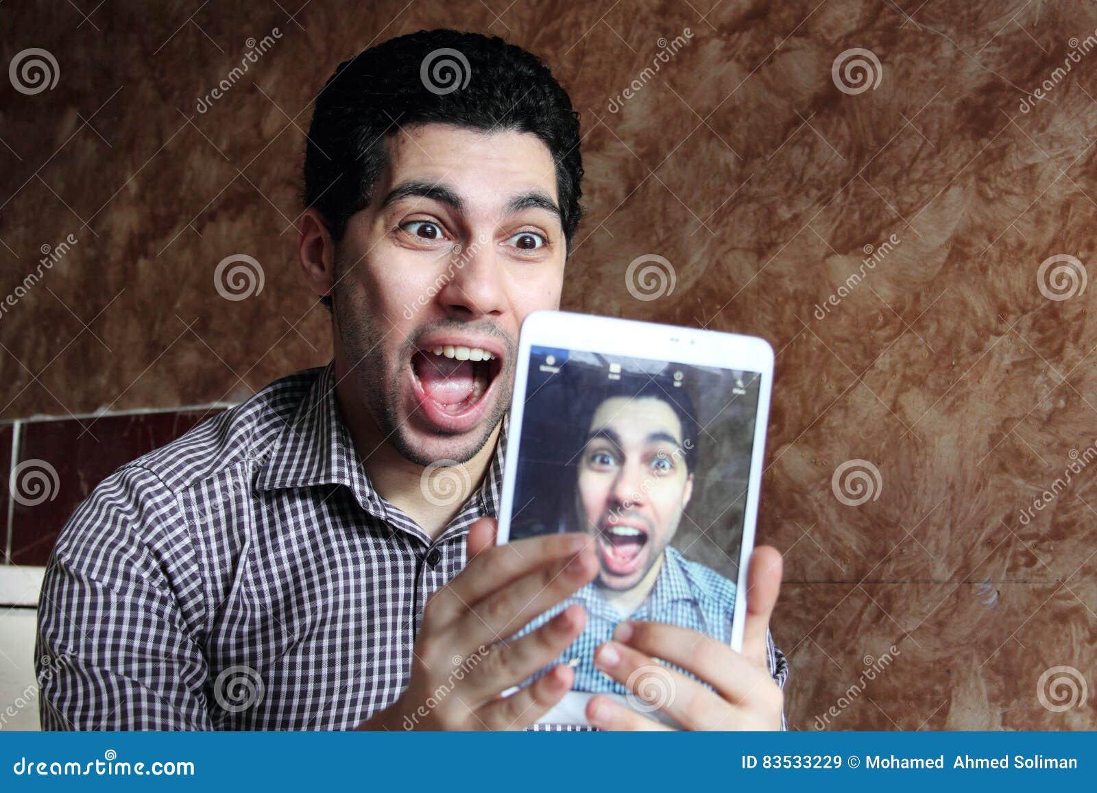 Crazy arab egyptian businessman taking selfie