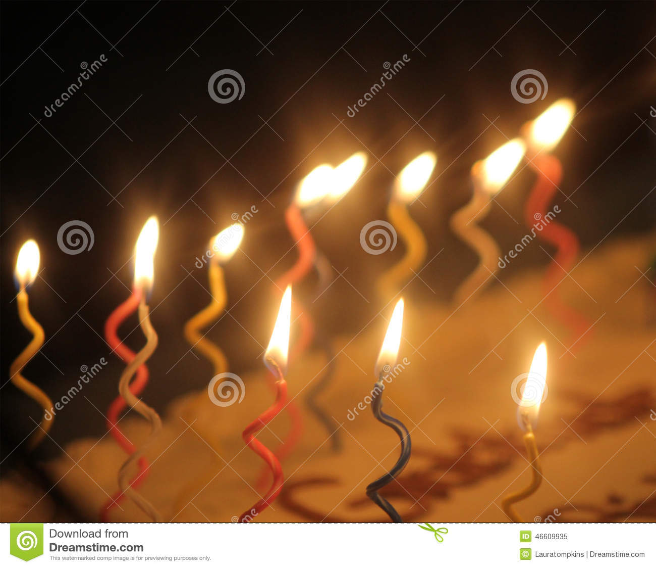 Blurry Colorful Wavy Lit Candles On A Cake