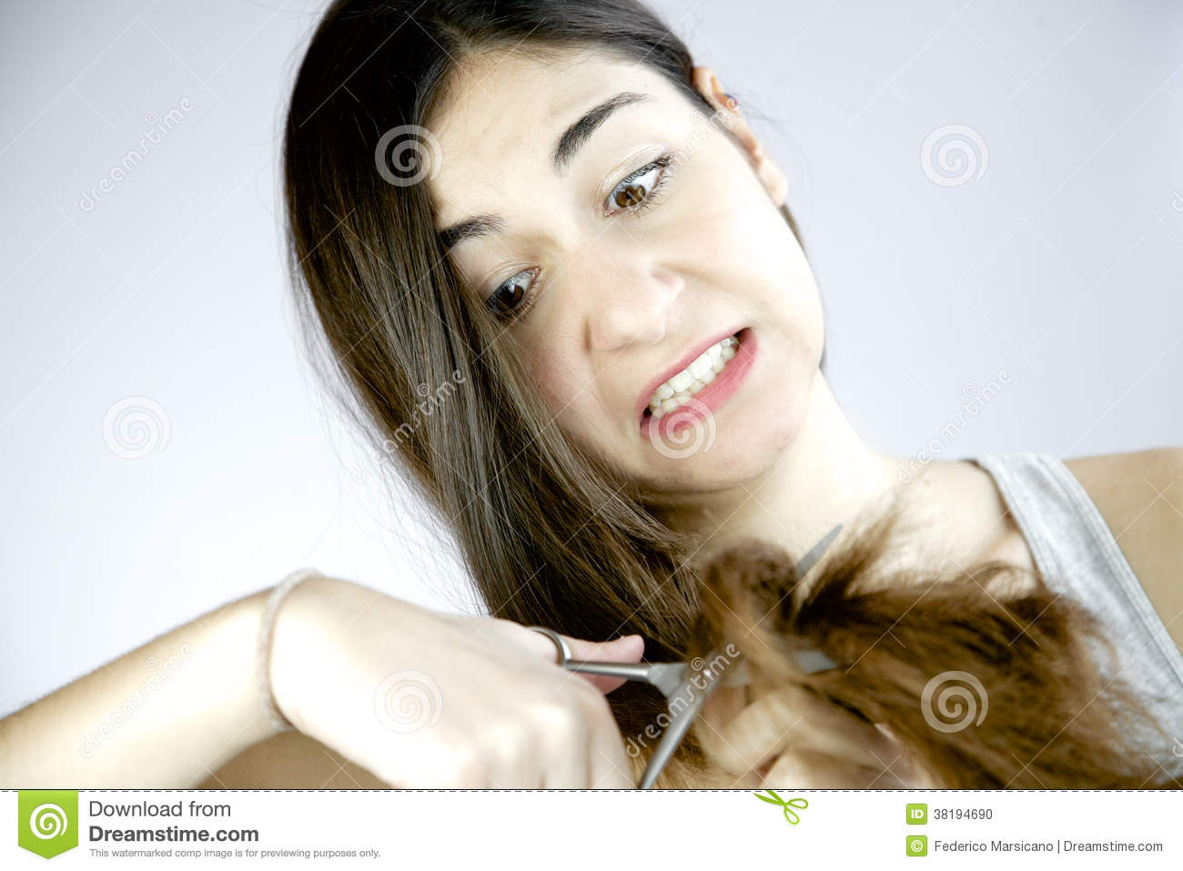 Crazy Girl Starting To Cut Her Long Hair For Desperation