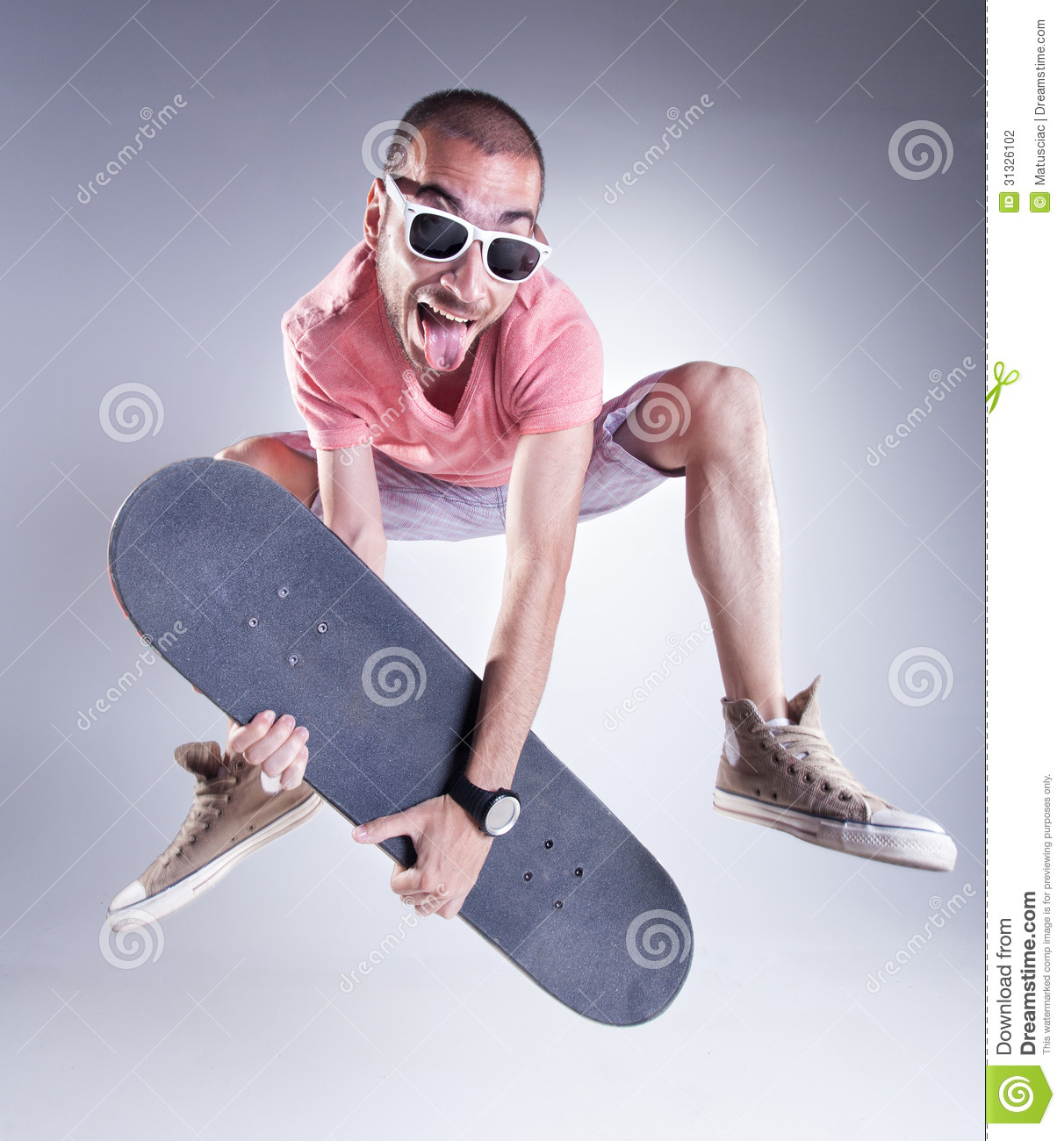 crazy guy jumping with a skateboard making funny faces