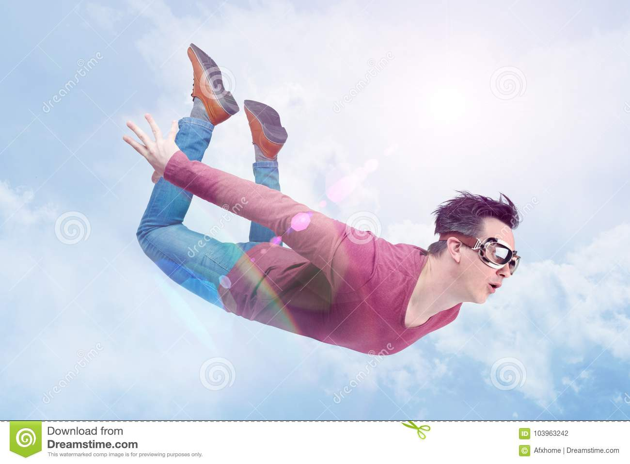 Crazy man in goggles is flying in in the cloudy sky. Jumper concept
