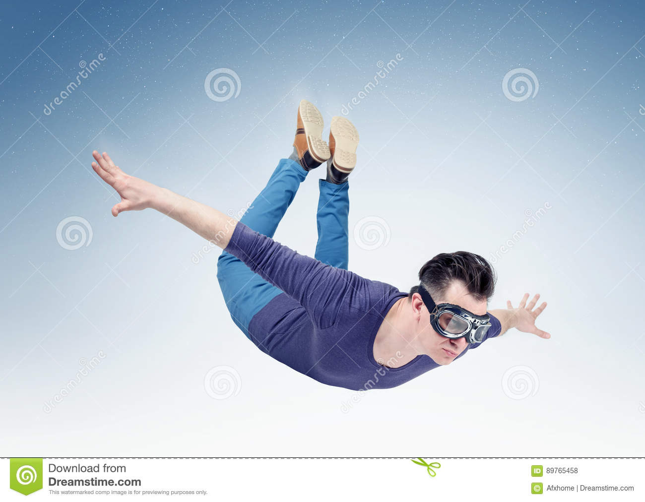 Crazy man in goggles is flying in the sky. Jump from orbit