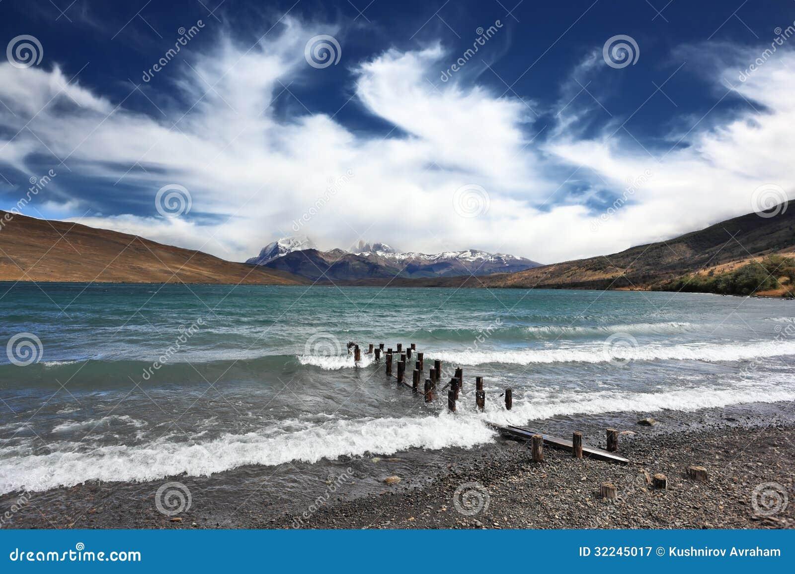 -storm-lake-boat-dock-poured-foaming-waves-mountains-surrounding-lake ...