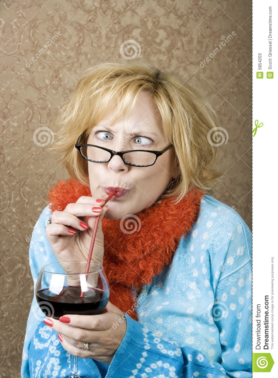 Crazy woman with crossed eyes drinking wine through a straw.
