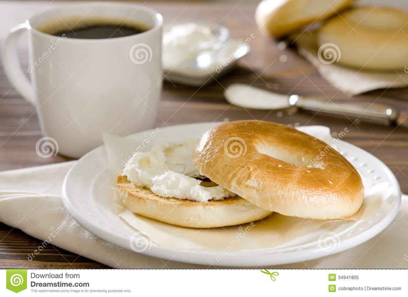 Cream cheese bagel stock image. Image of table, drink ...
