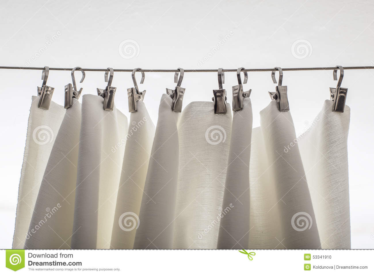 Cream-colored Curtain Hanging On A String On Metal Hooks Stock ...