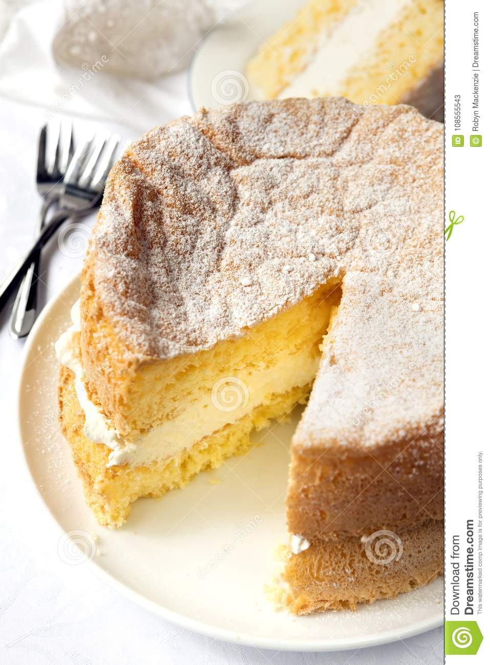 Cream Sponge Cake with Slice Cut out for Serving
