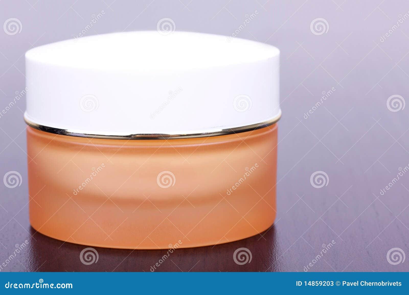 Cream in yellow box on black table