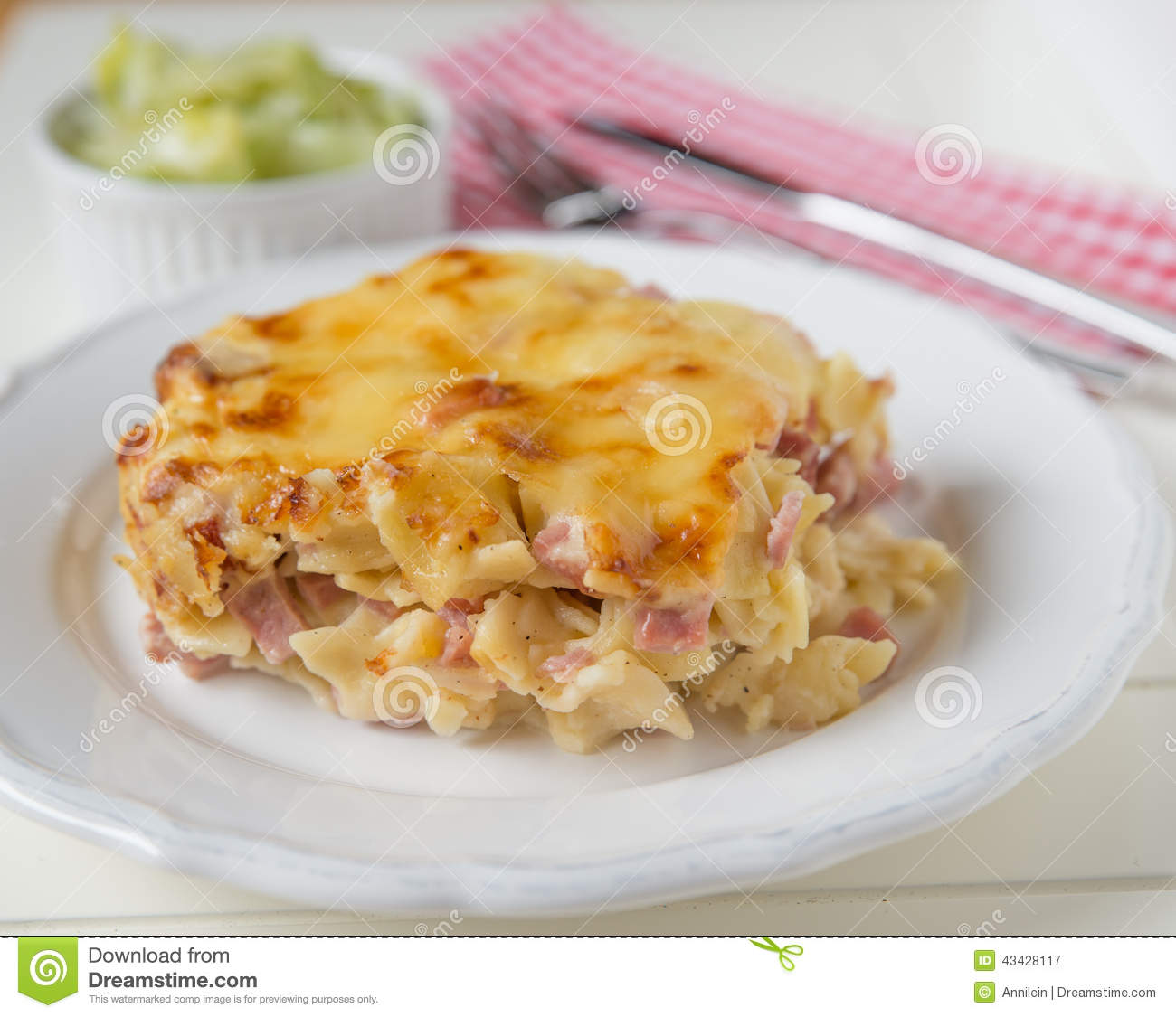 Creamy baked pasta with bacon and cheese and green salad.