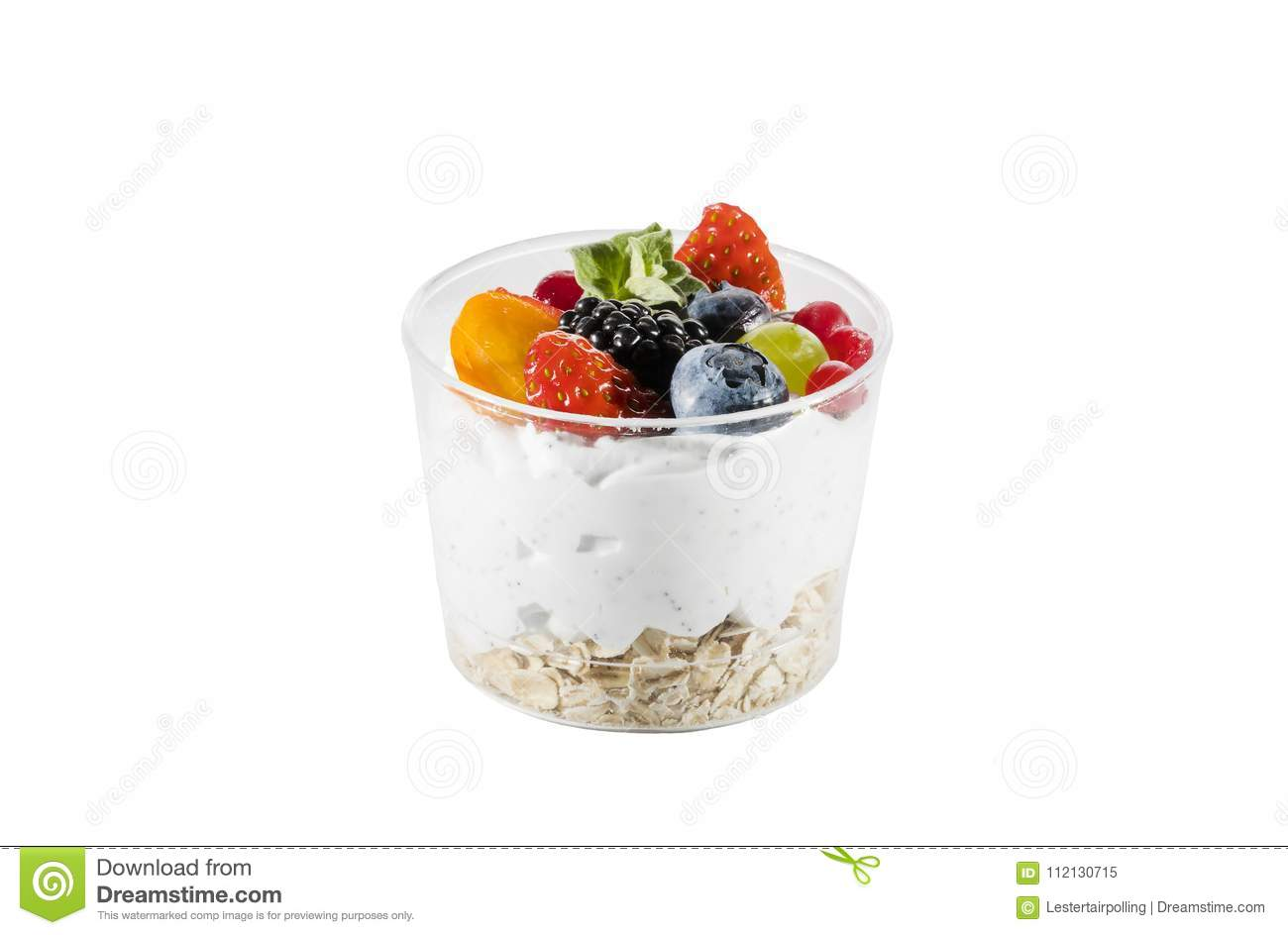 Creamy cream dessert in a plastic cup decorated with berries