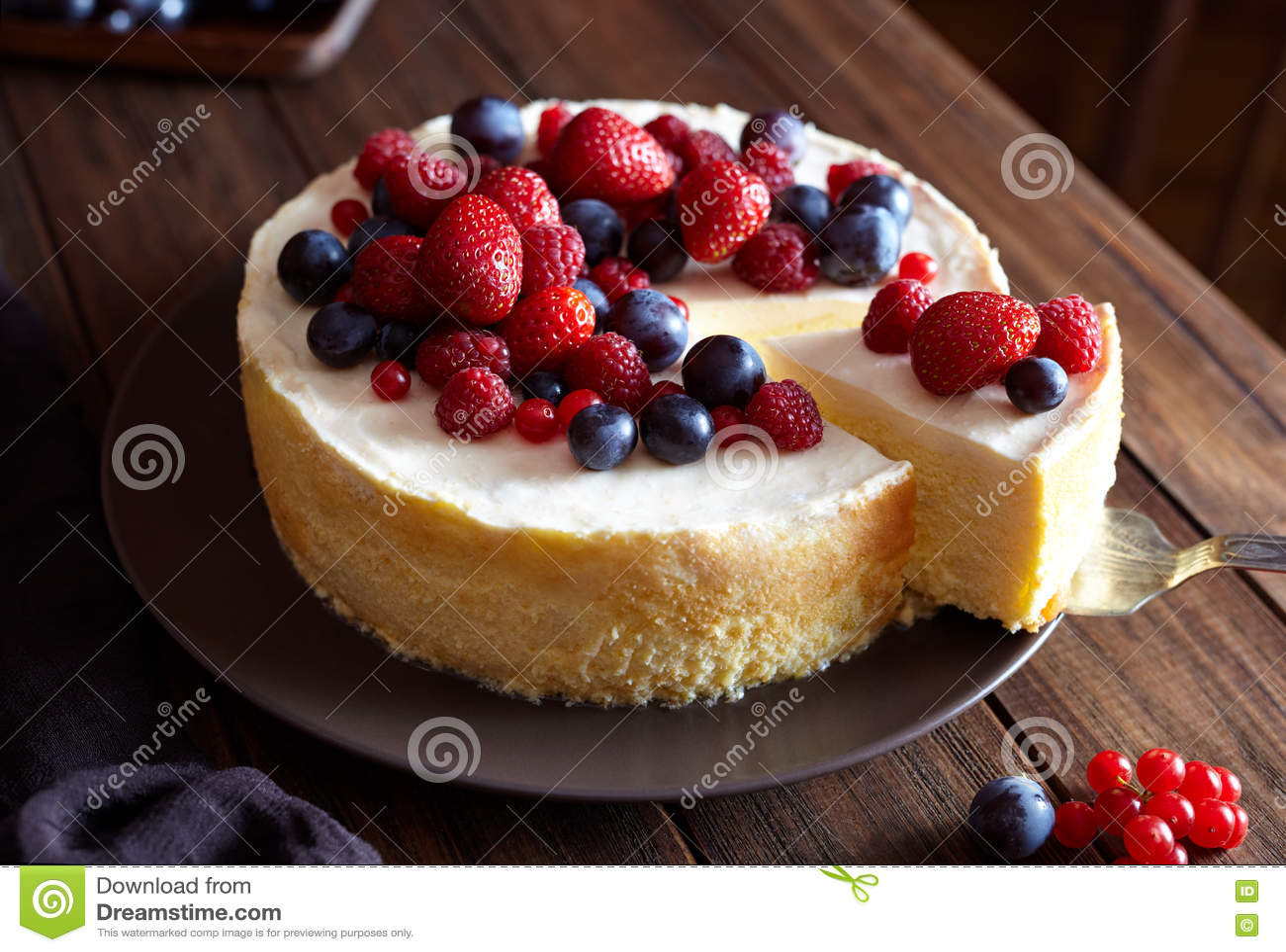 Creamy mascarpone cheese cake with strawberry and winter berries. New York Cheesecake. Close up.