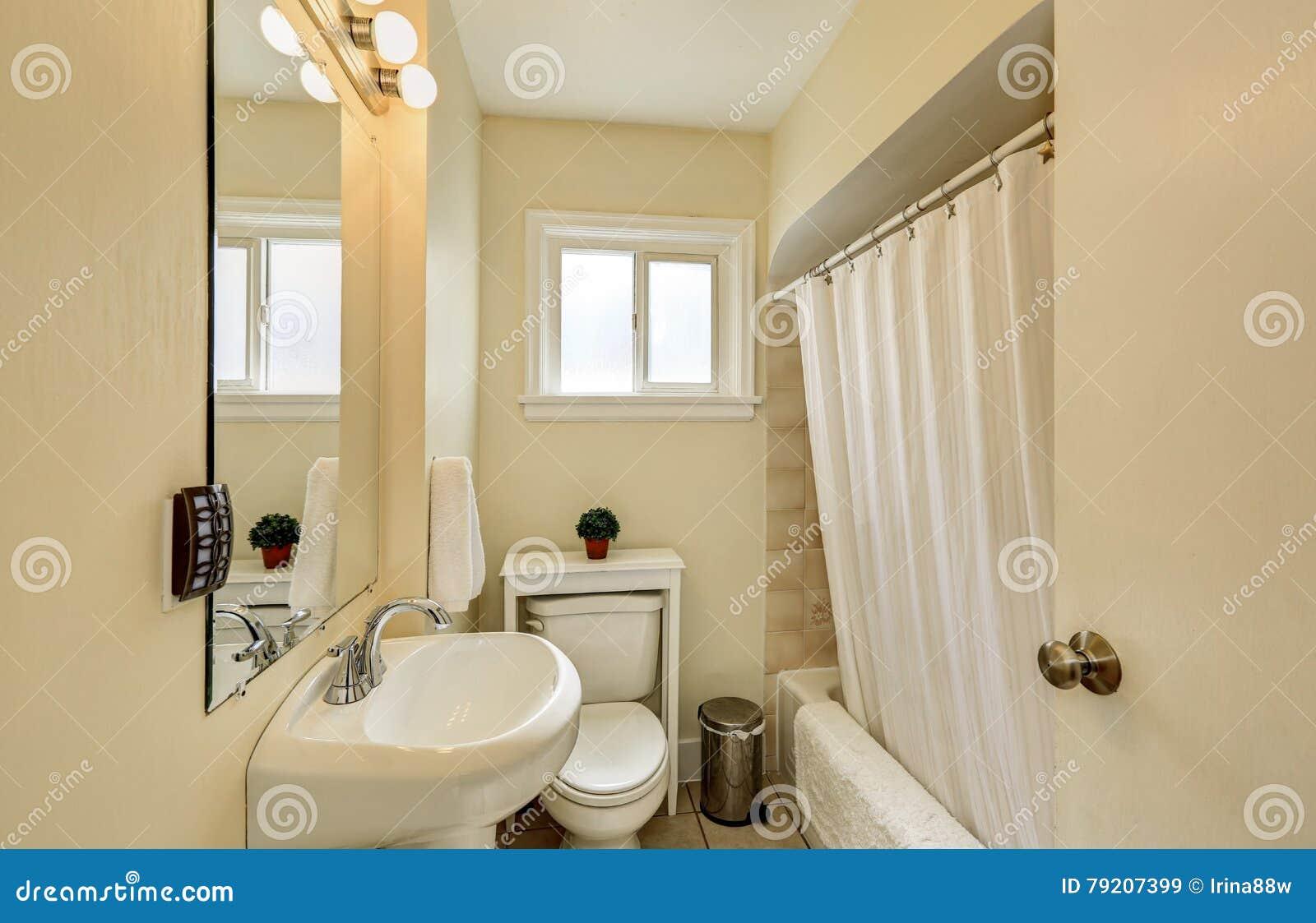 creamy tones bathroom interior in old craftsman house stock photo