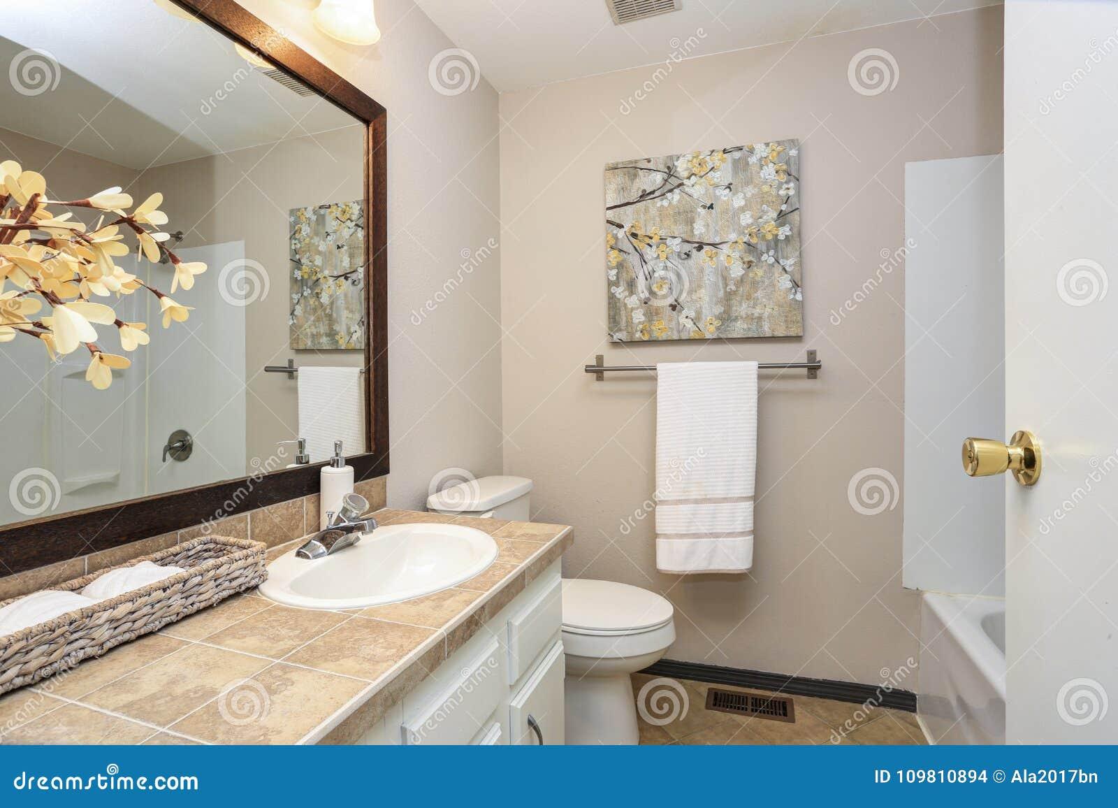 Creamy White Bathroom Boasts A Vanity Stock Photo - Image of idea ...