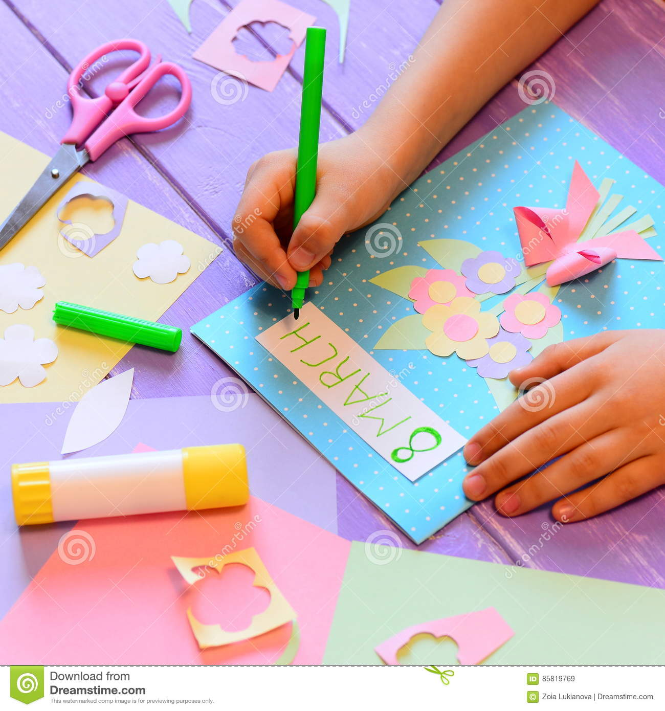Creating A Greeting Card With Flowers For Mom Child Holds A Pen In