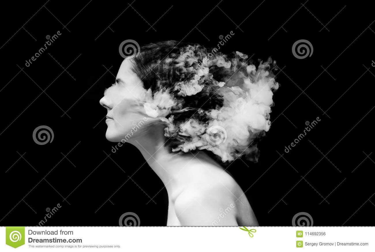 Creative of art woman portrait and smoke in face black in white portrait and smoke on black background