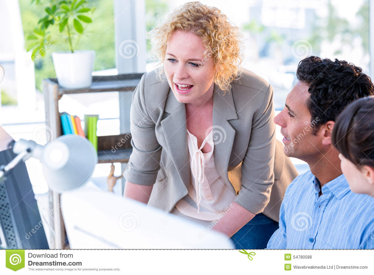 Creative Business People Working Together On Computer ...