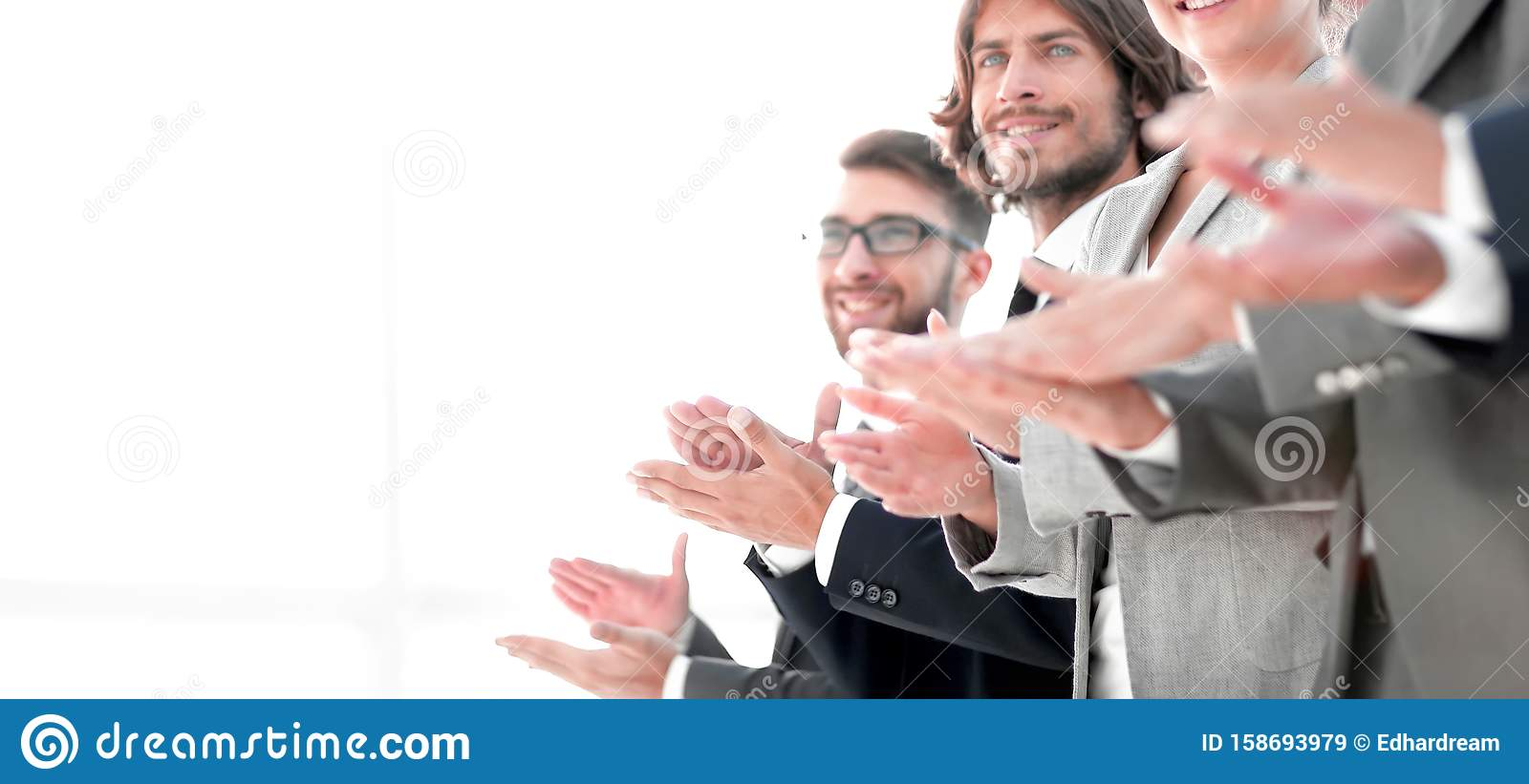 Creative business team applauding in officce