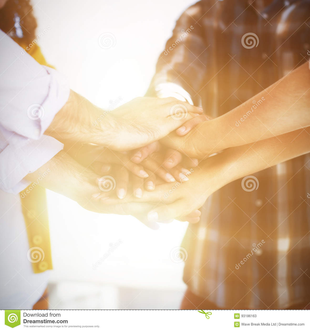 Creative business team stacking hands together