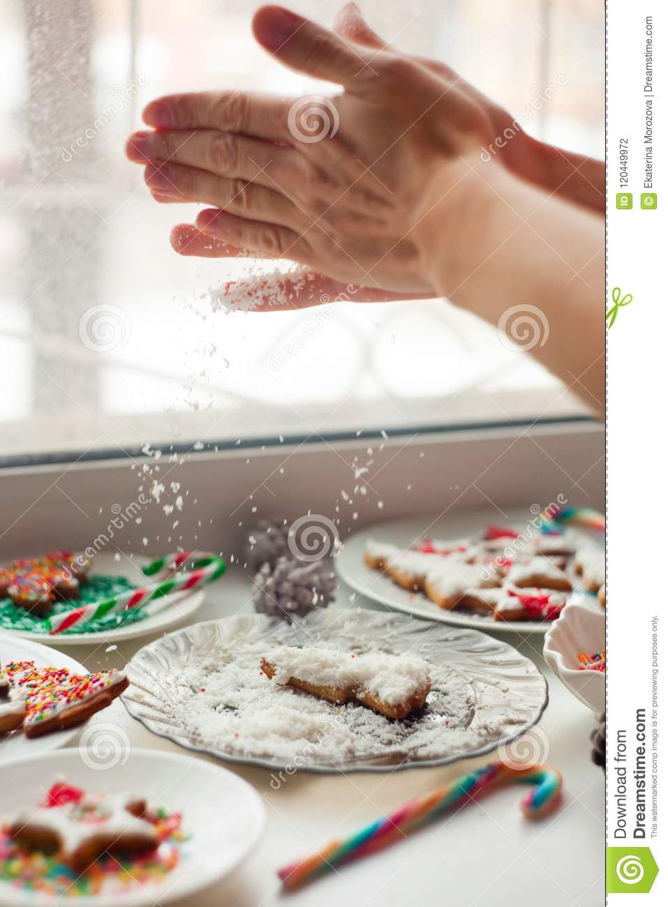 Creative Christmas Cookies On The White Plate Hands Sprinkle Crumbs