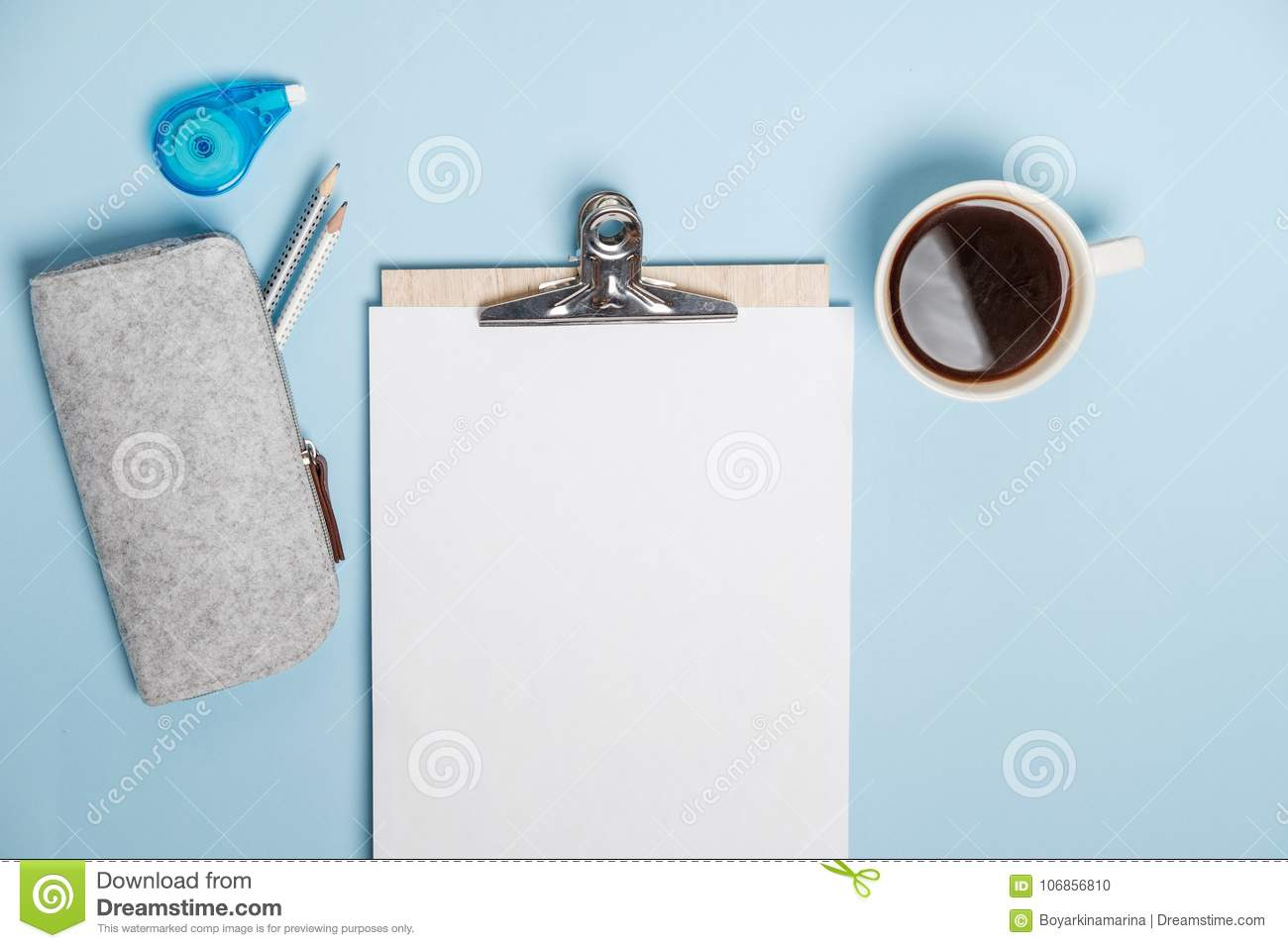 Creative Desktop With Laptop, Coffee And Stationery On Blue