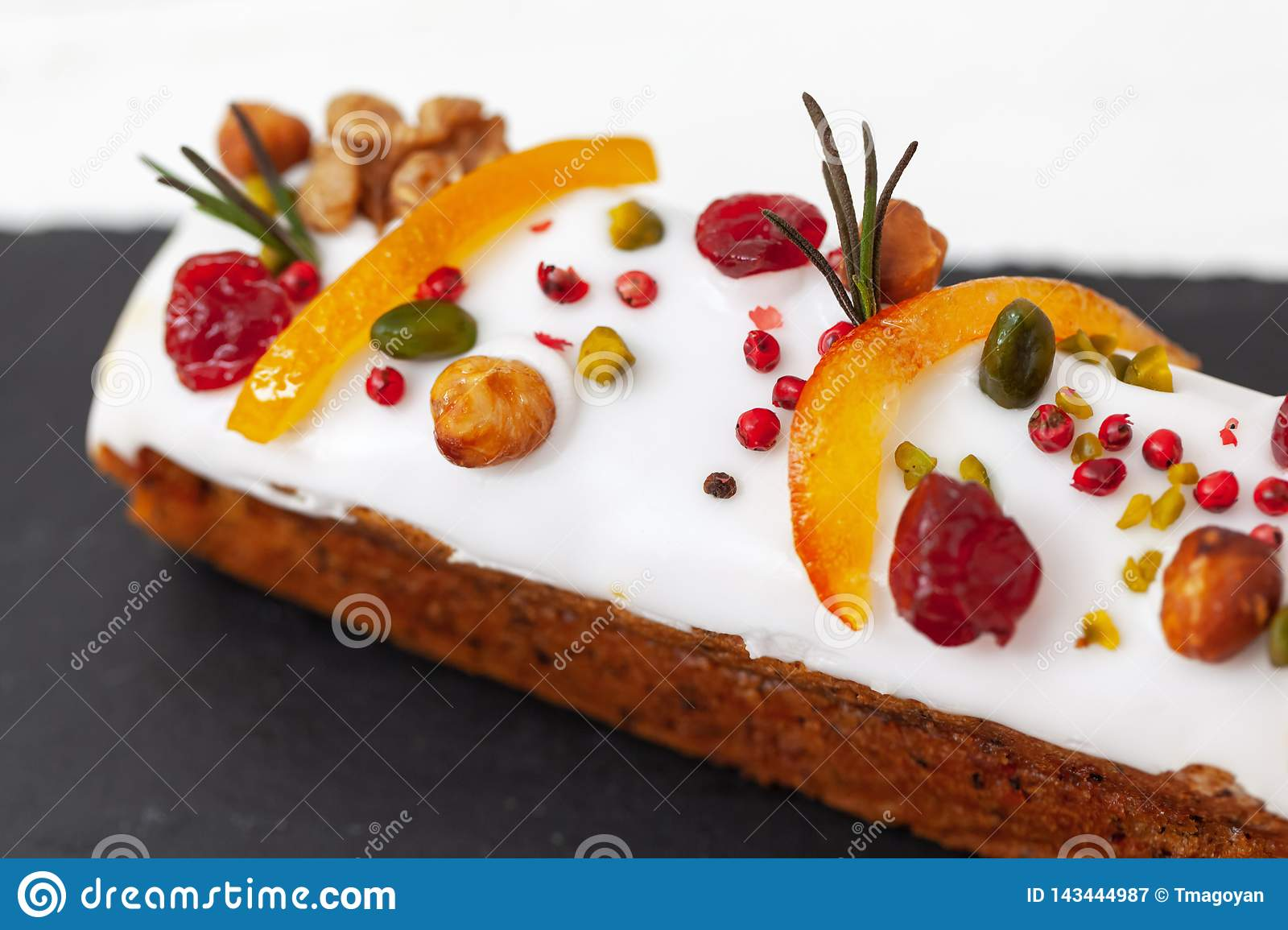 Creative Easter cake with nuts, dried fruits, candied fruit and spices. Happy Easter concept. Close-up. Macro. Selective focus