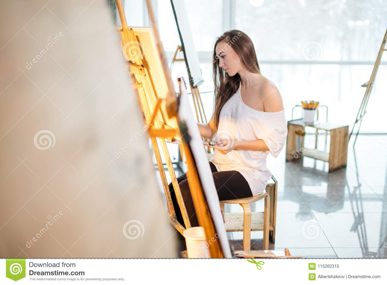 Young Painter Woman Producing Picture In Art Studio Stock