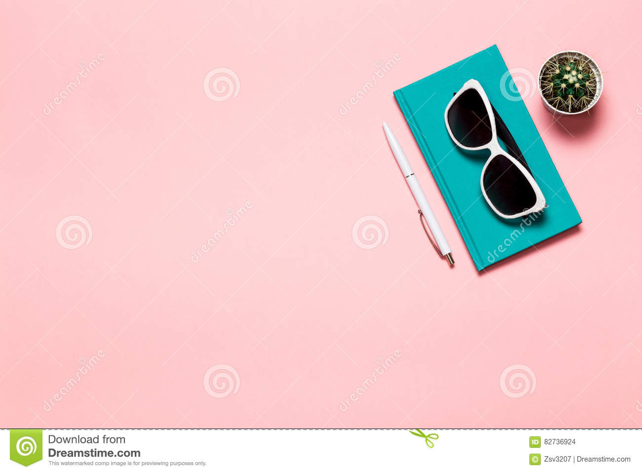Creative flat lay photo of workspace desk with aquamarine notebook, eyeglasses, cactus with copy space pink background