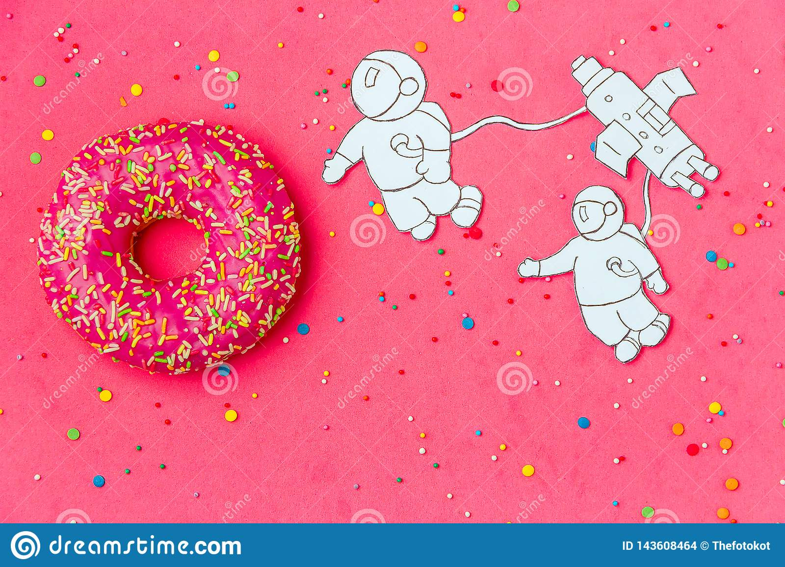 Creative Food Minimalism, Donut in Shape of Planet in Pink Sky with Astronaut, Space Ship Top View, Copy Space.