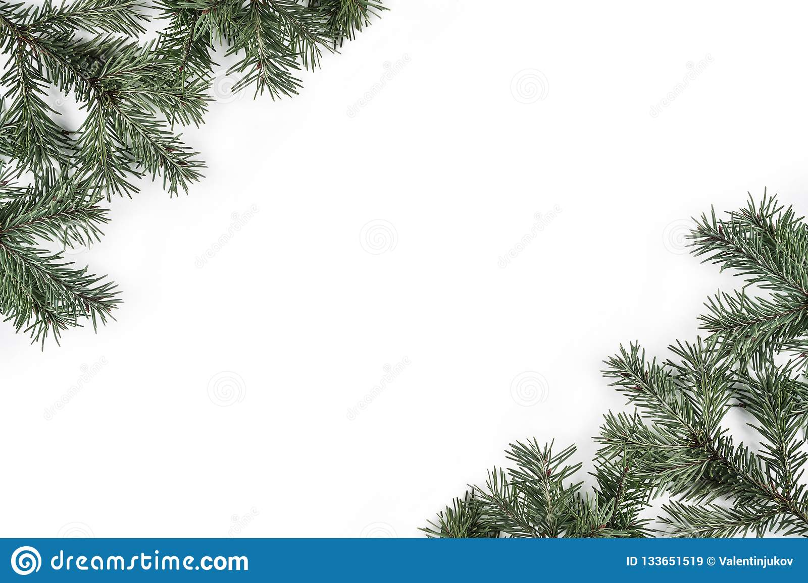 Creative frame made of Christmas Fir branches on white background. Xmas and Happy New Year theme.