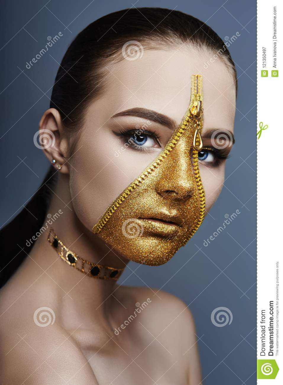 Creative grim makeup face of girl Golden color zipper clothing on skin. Fashion beauty creative cosmetics and skin care halloween