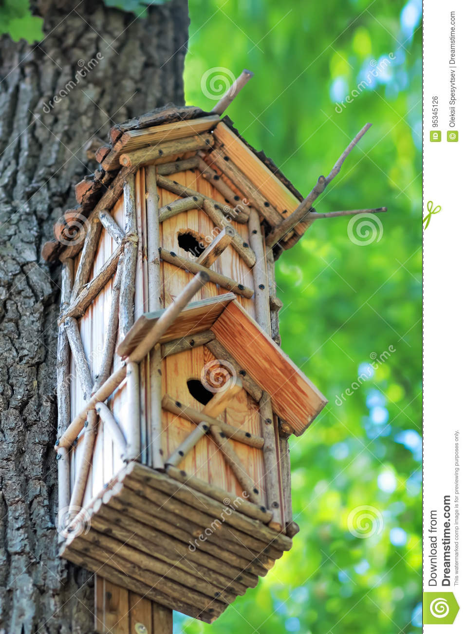 Fabulous Creative Hand Made Wooden Bird House Hanging On The Tree In Download Free Architecture Designs Scobabritishbridgeorg