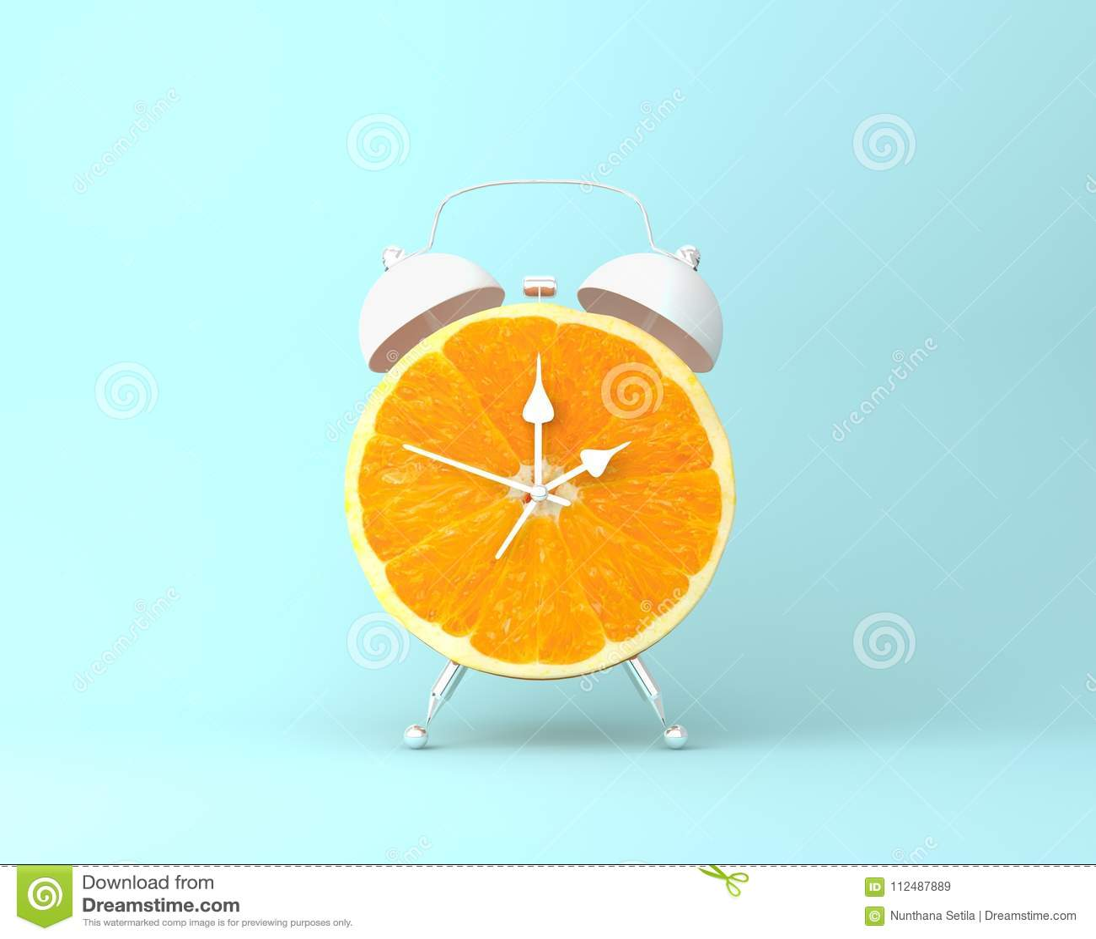Creative Idea Layout Fresh Orange Slice Alarm Clock On Pastel Bl