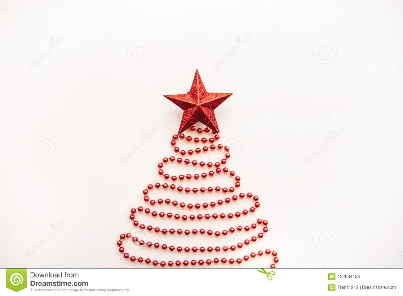 creative idea in minimalistic style for christmas or new year themes christmas fir tree from beads and a star on top festive concept