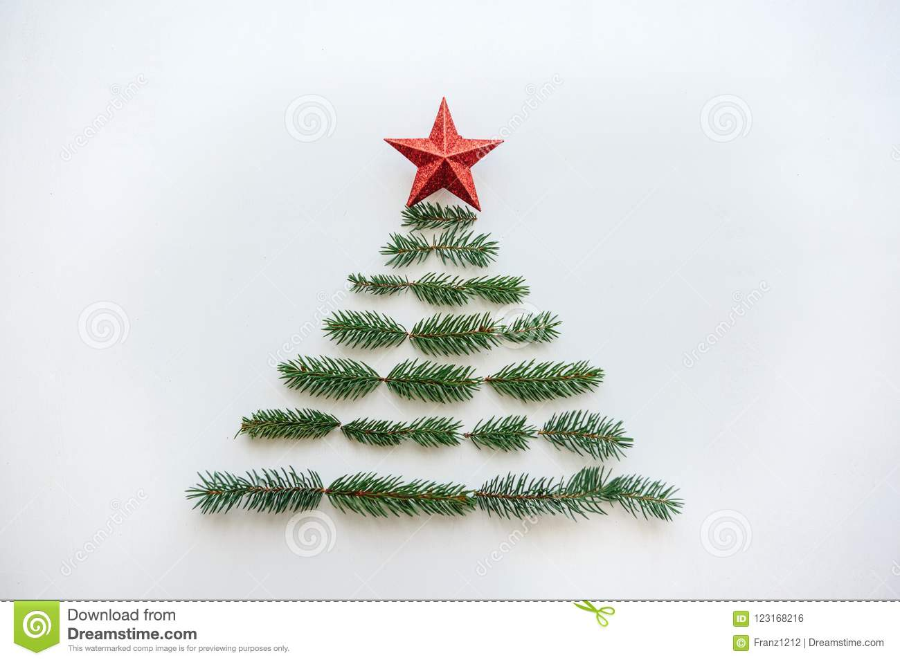 A Christmas Tree From Spruce Branches And A Star On Top. Stock Photo ...