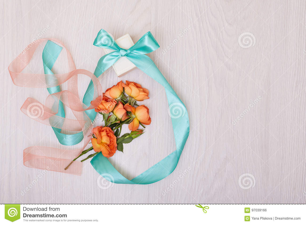 Creative Mock Up With A Card And Orang Rose Empty Sheet Of Paper
