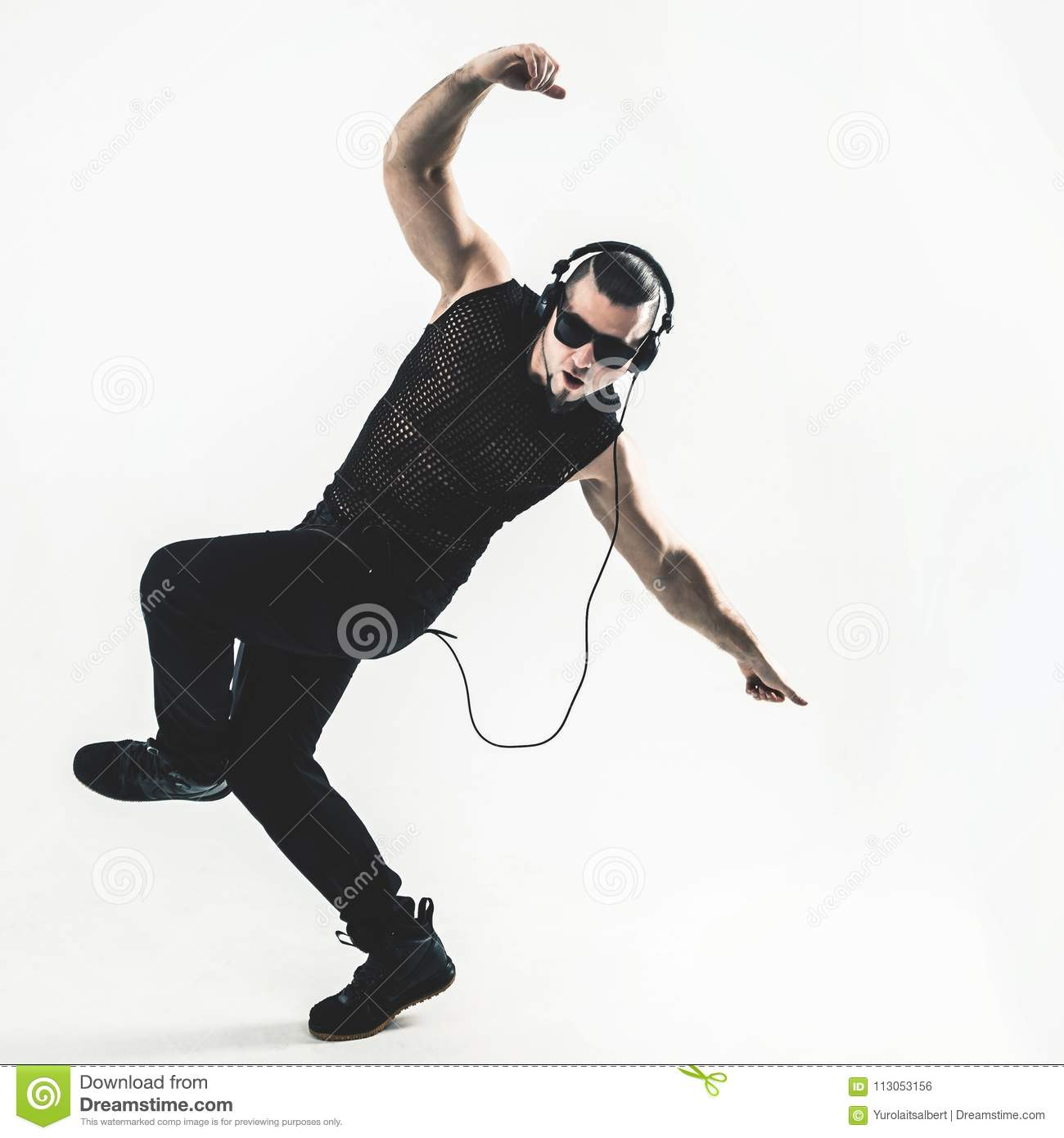 Creative rapper in the headphones and dark glasses performs a ra