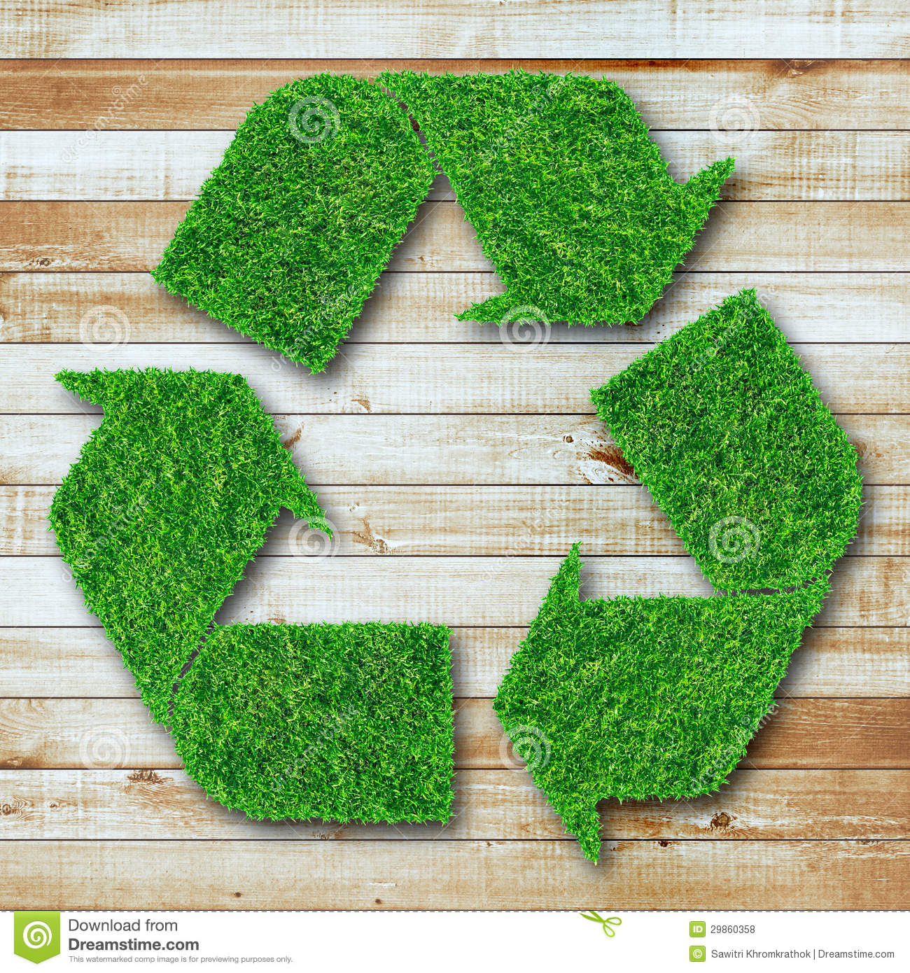Recycle Symbol From Grass On Wood Background Stock Photo