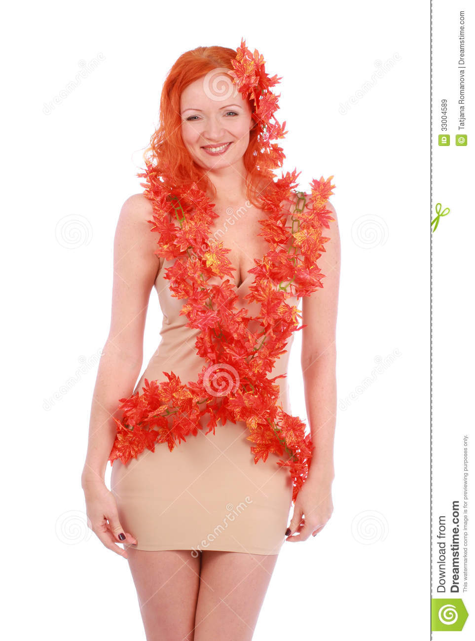 Creative shoot of smiling autumn young woman with red leaves