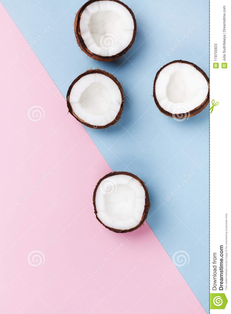 Creative summer pattern for modern design. Coconut fruit half on minimal pastel background top view. Flat lay.
