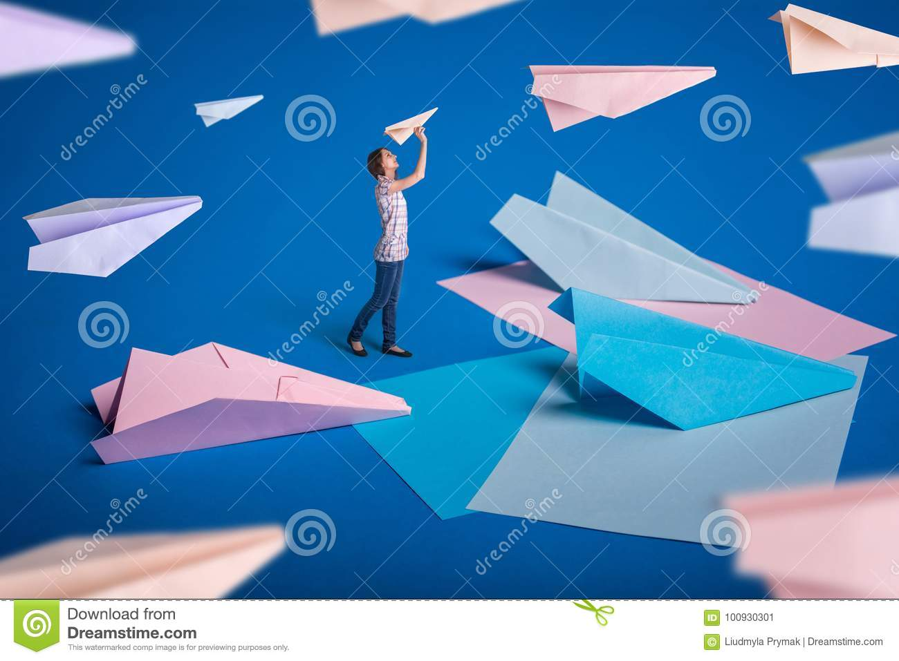 creative surrealism design with origami paper planes young girl let