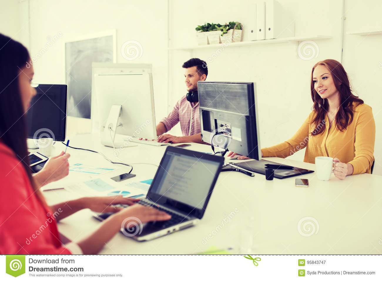creative team with computers working at office stock image image