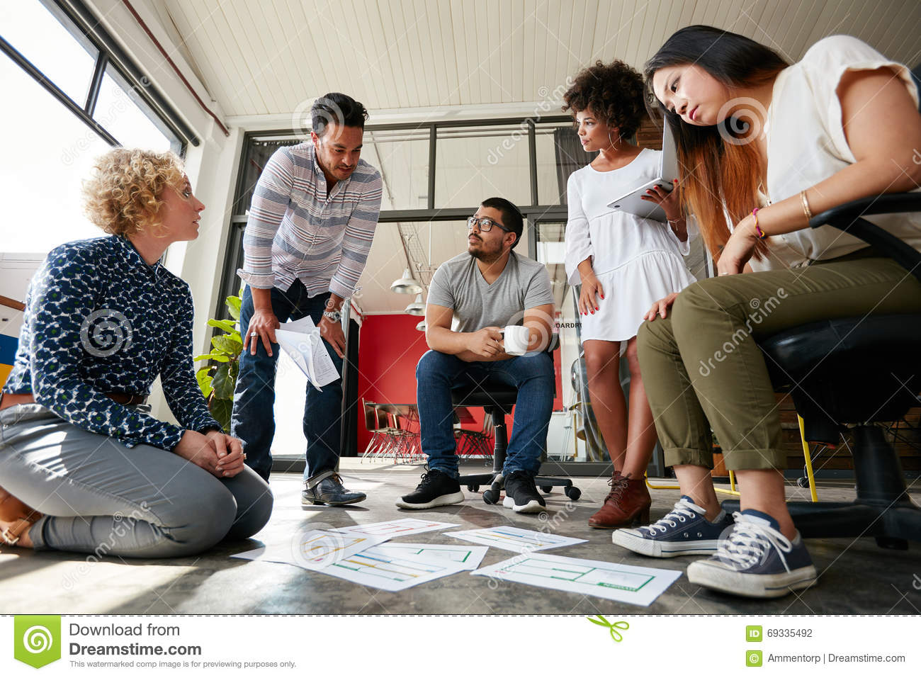 Creative Team Working On Floor At Work Space Stock Photo