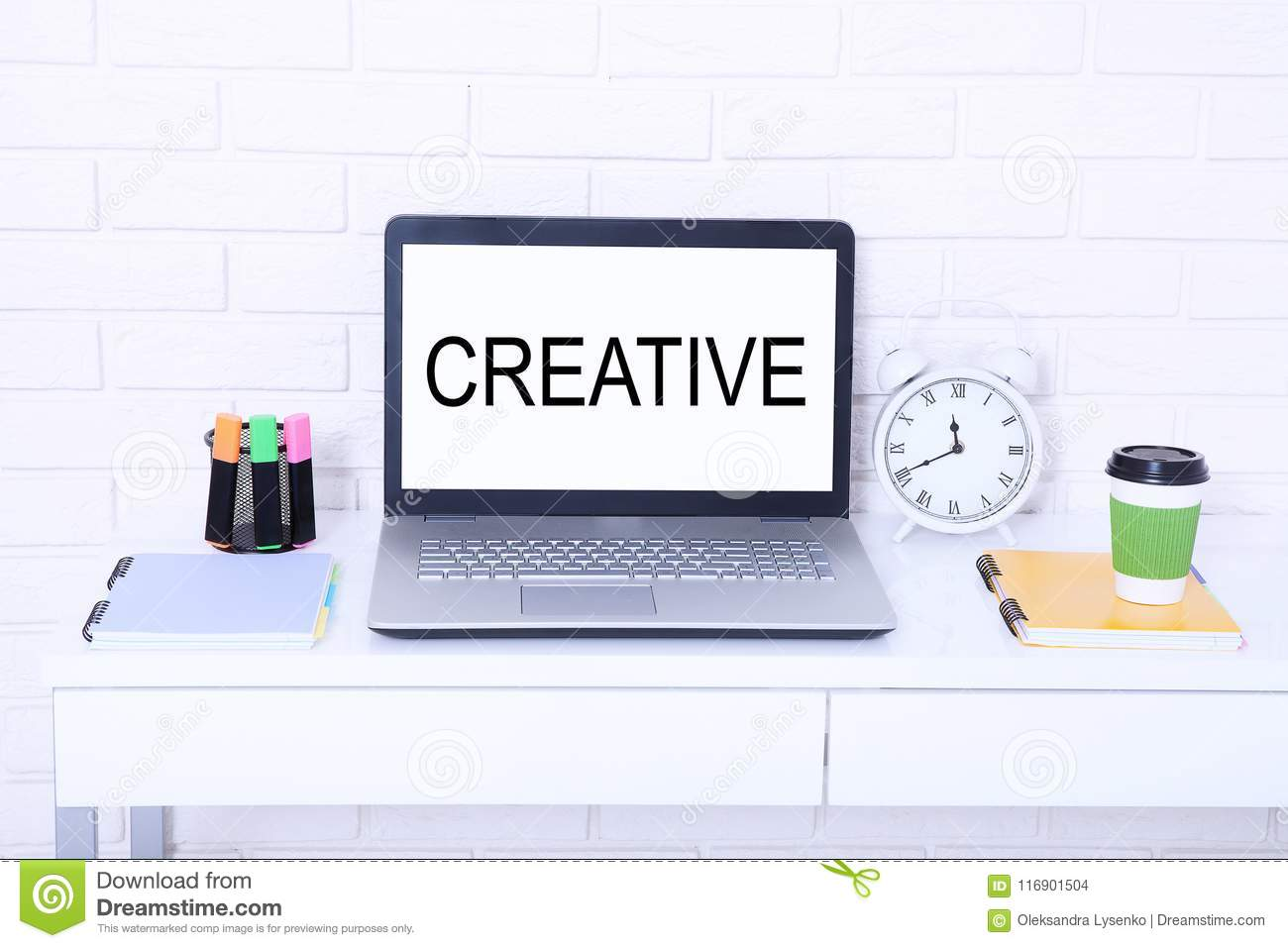 Creative. Text on monitor. Modern workplace with computer, cup of coffee and clock. Mock up and copy space