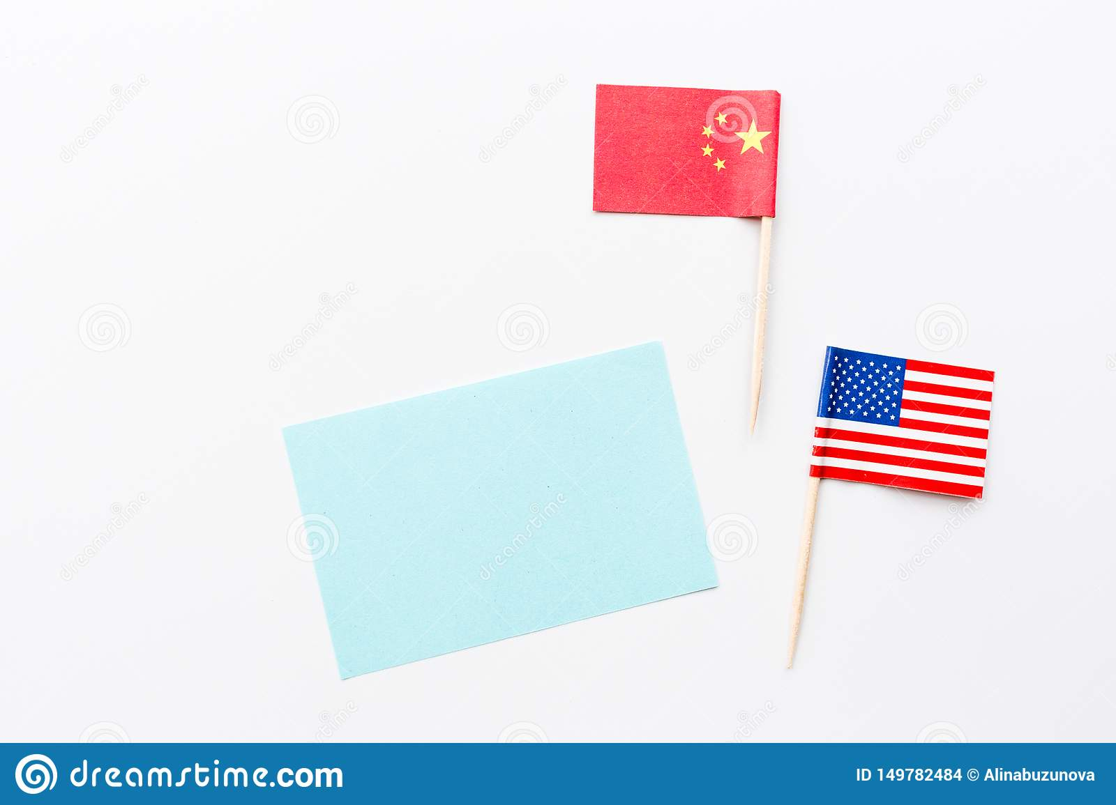 Creative top view flat lay of China and USA flag, mockup and copy space on white background in minimal style. Concept of