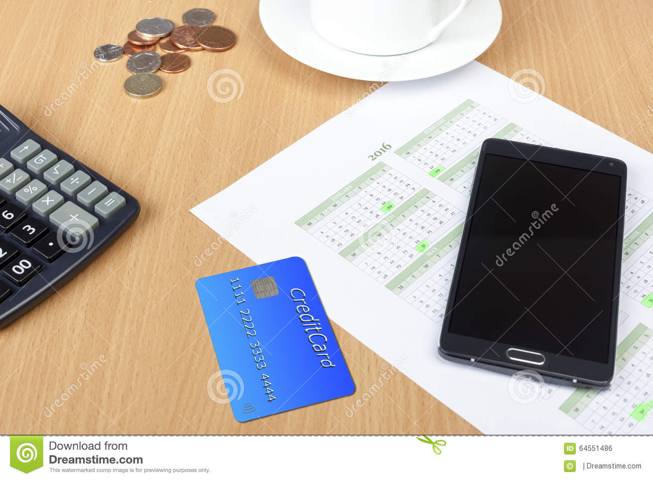Credit Card On A Desk With A Calculator And Calendar Stock